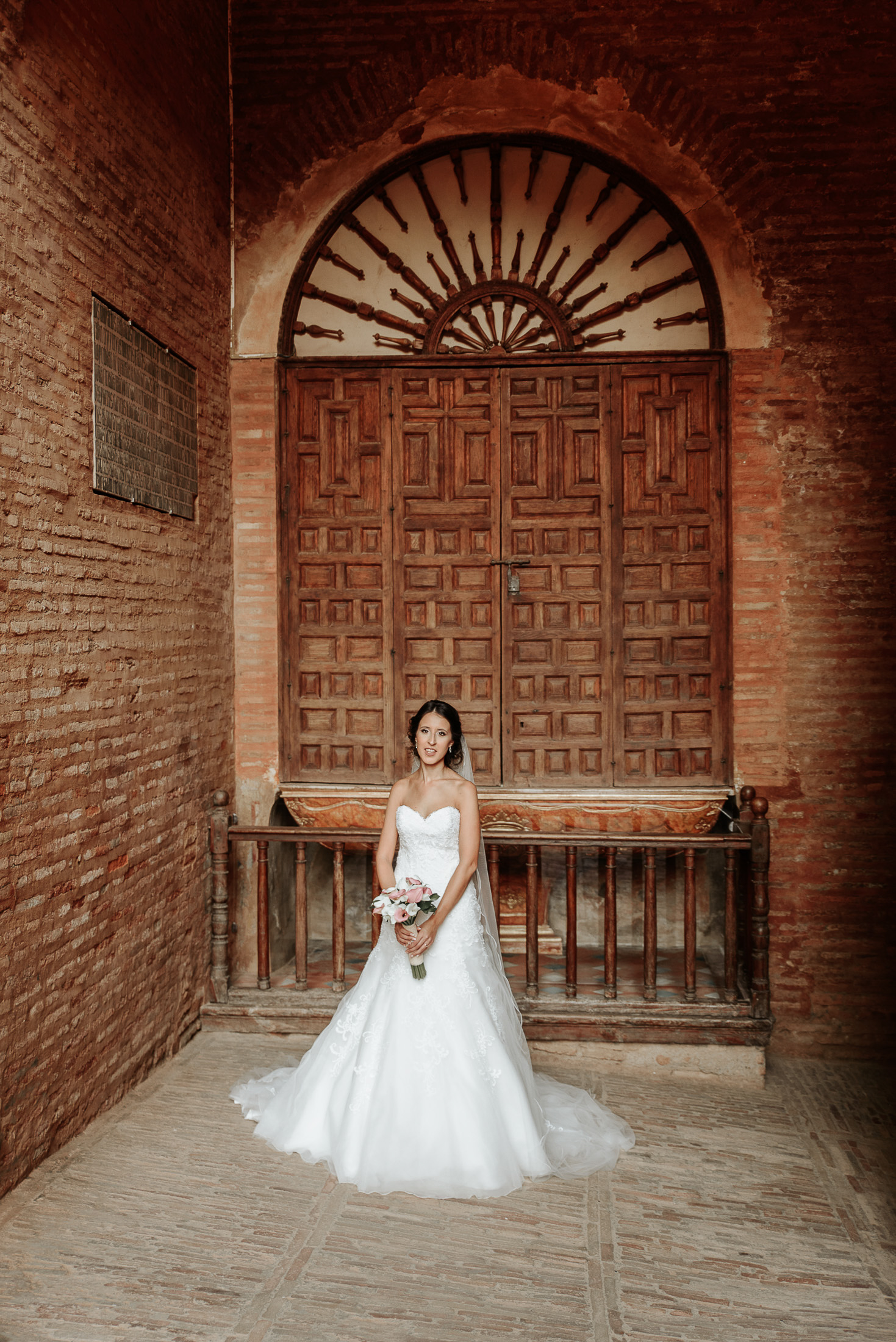 Bride in Gate of Justice, Wedding in Alhambra